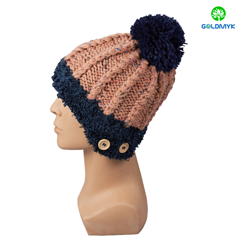 Twist knitted hat with pom pom