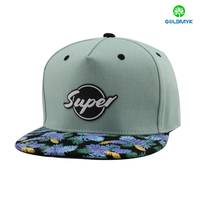 100% cotton snapback cap with rubber patch and flower printing visor