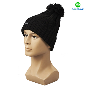 Black knitted hat with woven patch on cuff